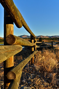 Rail fence above Big Twin at sunrise