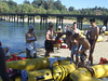 Getting ready to get into the river - putting on sun screen.