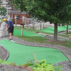 Record-Eagle/Lindsay VanHulle<br /> Doug Jensen, of Ionia, left, and his wife, Stephanie, play a round of miniature golf Monday at Pirate's Cove in Traverse City. The couple celebrated 12 years of marriage in Traverse City during Labor Day weekend.