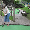 Record-Eagle/Lindsay VanHulle<br /> Stephanie Jensen, of Ionia, prepares to putt Monday at Pirate's Cove miniature golf course in Traverse City. She and her husband, Doug, celebrated 12 years of marriage in Traverse City during Labor Day weekend.