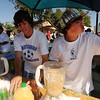 "Ryan Ebersole, left, and Luke Nichols, both of the Centaurus soccer team, volunteer with other players making smoothies, serving peach pie and cobbler at the Peach Festival.<br /> The annual Lafayette Peach Festival was held downtown on Saturday.<br />  For more photos and a video, go to  <a href=""http://www.dailycamera.com"">http://www.dailycamera.com</a>.<br /> Cliff Grassmick / August 22, 2009"
