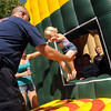 "Ashli Martin of Lafayette jumps out of the Lafayette Fire Safety  House at the festival.<br /> The annual Lafayette Peach Festival was held downtown on Saturday.<br />  For more photos and a video, go to  <a href=""http://www.dailycamera.com"">http://www.dailycamera.com</a>.<br /> Cliff Grassmick / August 22, 2009"