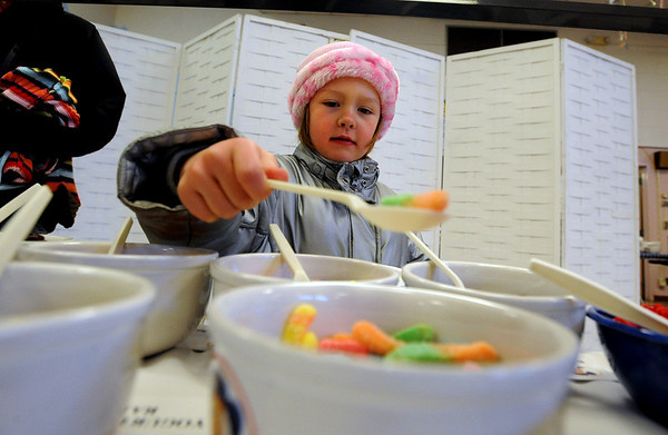 """Anna Furey, 5, picks her favorite oatmeal toppings.<br /> The 14th annual Lafayette Oatmeal Festival was held Saturday. For more photos and a video, go to  <a href=""""http://www.dailycamera.com"""">http://www.dailycamera.com</a>.<br /> Cliff Grassmick / January 8, 2011"""