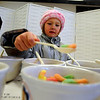 "Anna Furey, 5, picks her favorite oatmeal toppings.<br /> The 14th annual Lafayette Oatmeal Festival was held Saturday. For more photos and a video, go to  <a href=""http://www.dailycamera.com"">http://www.dailycamera.com</a>.<br /> Cliff Grassmick / January 8, 2011"