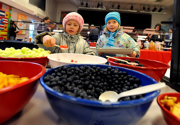 "Anna Furey, 5, left, and her sister, Kira, 8,  pick their favorite oatmeal toppings.<br /> The 14th annual Lafayette Oatmeal Festival was held Saturday. For more photos and a video, go to  <a href=""http://www.dailycamera.com"">http://www.dailycamera.com</a>.<br /> Cliff Grassmick / January 8, 2011"