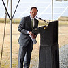 Mass Department of Energy Resources Commissioner Mark Sylva speaks at the podium during the ribbon cutting ceremony for Lancaster's solar array on Route 70, Friday.<br /> SENTINEL & ENTERPRISE / BRETT CRAWFORD