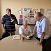 Chuck Helton pushing Kindle to Bob Garrett and George Cochran