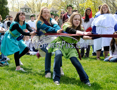 4/28/2010 Mike Orazzi | Staff Southington High School students, left to right, Elise Bean, Alyssa Pappas and Jessica Corcanges while competing in the tug of war during Latin Day at Holiday Hill in Prospect on Wednesday.