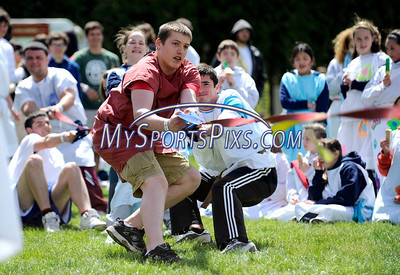 4/28/2010 Mike Orazzi | Staff Bristol Central High School students Seth Michelson and Kyle Pecevich lead the Central team while competing in the tug of war during Latin Day at Holiday Hill in Prospect on Wednesday.