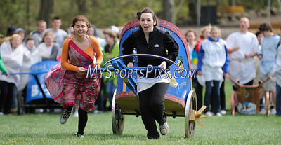 4/28/2010 Mike Orazzi | Staff St. Paul Catholic High School students Jamie Schiopucie and Adrienne Cieruo competes in the chariot races during Latin Day at Holiday Hill in Prospect on Wednesday.