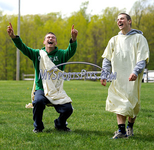 4/28/2010 Mike Orazzi | Staff Southington High School students Tim Leahy (left) and Jim Hammond (right) celebtrate after taking  first place in the chariot races during Latin Day at Holiday Hill in Prospect on Wednesday.
