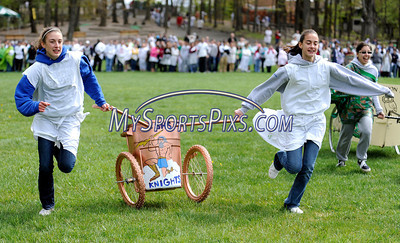 4/28/2010 Mike Orazzi | Staff Southington High School students Maeghan Chapman (left) and Kathy Amnott compete in the chariot races during Latin Day at Holiday Hill in Prospect on Wednesday.