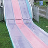Gary Church/NEWS<br /> Rain put a damper on opening-day activities at the Lawence County Fair yesterday, as this water-filled slide shows.