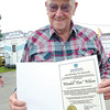 Debbie Wachter/NEWS<br /> Wendall Don Wilson holds a certificate he was presented by the state secretary of agriculture for the 30 years he served as a Lawrence County Fair board member. Wilson, who retired from the board a couple of years ago, was responsible for a lot of the upgrades and betterments on the fairgrounds.