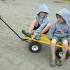 Debbie Wachter/NEWS<br /> Six-year-old twins Aberdeen and Angus Dean get a ride to the Lawrence County Fair dairy barns on a wagon.