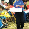 Debbie Wachter/NEWS<br /> Ryan Telesz exhibits a basket of cheese for his brother at the Dairy Delight cheese auction at the fair.