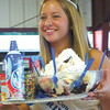 Debbie Wachter/NEWS<br /> Lawrence County dairy princess Jamie Trotter auctions off a giant sundae at Dairy Delight night.