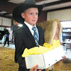 Debbie Wachter/NEWS<br /> Turk Davis carries cheese for Thomas Beatty during the cheese auction at the fair.