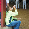 Debbie Wachter/NEWS<br /> Hayden Stewart, 11, of East Palestine, Ohio, enjoys a free bottle of chocolate milk that vendors were giving out at the junior dairy show at the Lawrence County fair.