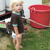 Debbie Wachter/NEWS<br /> Bentley Buckley, 22 months, of Stoneboro stands in his pajamas Monday morning outside his family's pumpkin funnel cake stand at the Lawrence County Fair.