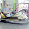 Gary Church/NEWS<br /> Lyndon Conrad of Perry Township, rides a bumper car at the Lawrence County Fair yesterday with his granddaughter, Alexis Lindley, 4, of Neshannock Township.