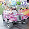 Gary Church/NEWS<br /> Taking a ride on the car merry-go-round at the Lawrence County Fair yesterday are Anna McCullough, in the front seat and Reagan Miller. Both are 3 years old and from Plain Grove.