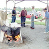 Gary Church/NEWS<br /> George Brenneman, stirs apple butter for local Grange organizations at the Lawrence County Fair yesterday, Also shown are from left are, Dave Harvey, John Skiba and Rick Jones.