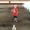 Gary Church/NEWS<br /> Junior Granger Chase Kosciuszko tries his hand at milk bottle bowling yesterday at the Lawrence County Fair.