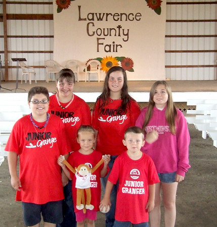 Gary Church/NEWS<br /> Junior Grange members were on hand at the Lawrence County Fair yesterday to lend a hand with games for children. Shown above are: front row, from left, Eric Jones, Haley Porada and Chase Kosciuszko. Back row, from left, are Lila Jones, Mackenzie Kushma and Jordan Comstock. Haley is holding Jammin-George, the state junior grange mascot, which is visiting the county fair.