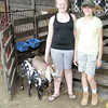 Gary Church/NEWS<br /> Hailey Norden, left, 11, of New Wilmington, and Alyssa Wilson, 12, Laurel area, stand with some goats. They were at the Lawrence County Fair representing Unexpected Acres farm.