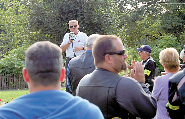 Evangelist Randy Crum of Vision Ministries gives riders final safety instructions before leaving Cascade Park. — Sam Luptak Jr.