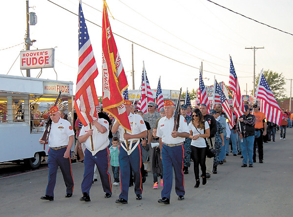 An honor guard and flag brigade also led Fallen Warrior Ride participants into the fairgrounds and on to Building No. 5, where the For God and Country Crusade would take place. — Sam Luptak Jr.