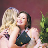 Tiffany Wolfe/NEWS<br /> Caroline Orrico of Neshannock High School, 2015 Lawrence County Distinguished Young Woman receives a hug from last year's winner Miranda Nichols as firstrunner up Carly Danielson of Shenango High School looks on.