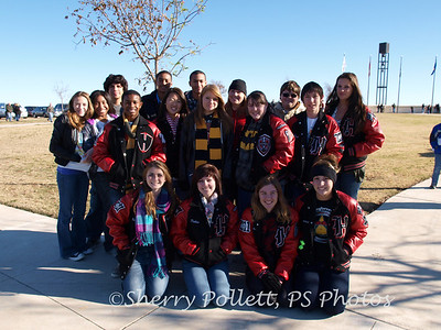 Some of the HHHS Red Brigade Band members who volunteered to help lay wreaths.