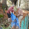 Over 30 trash bags of leaves are collected and carried off for compost.