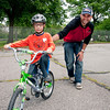 Becquer Peña of Morris Heights receives a helping hand from his dad, Socrates at Learn to Ride a Bike Day at Crotona Park.