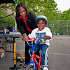 Learn-to-Ride-a-Bike Instructor Cheryla Shepard holds on to Christopher Cload Lee of Coop City.