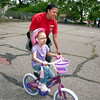 Bike Instructor Josefina Guzman guides Camila Peña of Morris Heights as she learns to pedal her way on her bike.