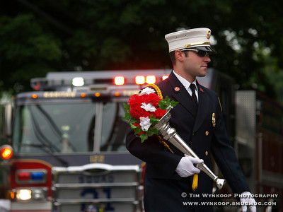 Raritan Township Fire Department deputy chief, Joseph Petrella, carries the symbolic firemans's horn with flowers in the Lebanon Borough Fourth of July parade Wednesday.