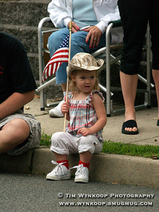 Lebanon Borough, NJ, 7-4-2007: 2 year old Amanda Johnson of Bloomsbury, shows her American pride as the annual Lebanon Borough Fourth of July parade makes it way through the borough Wednesday. (Photo by: Tim Wynkoop)