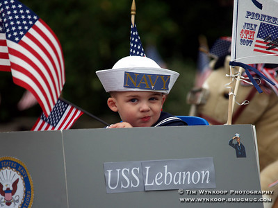 Lebanon Borough, NJ, 7-4-2007. 2 year old Gianni Coppeto, of Clinton Township, pilots his USS Lebanon during the annual Lebanon Borough Fourth of July parade, Wednesday in the borough. (Photo by: Tim Wynkoop)