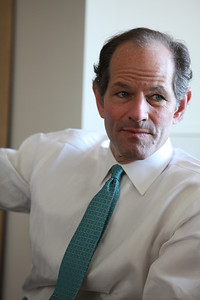E. Spitzer