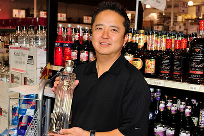 And son - - Kenny Lee, son of Mister Lee, owners of Lee's Discount Liquor holds a bottle of iS Vodka in this photograph at his store on Sunset and Green Valley Parkway in East Las Vegas.