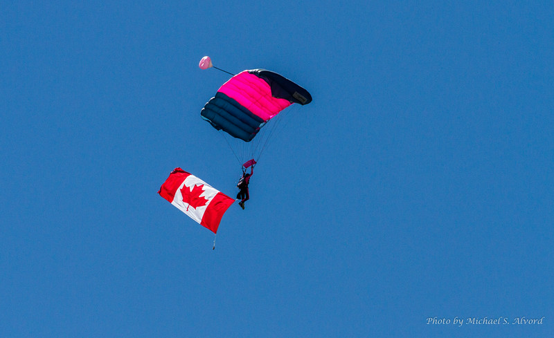 Because there were flight teams from both Canada and the US they displayed both flags.