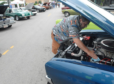 Erica Benson-ebenson@shawmedia.com Steve Cozzolino of Lemont cleans his engine during the Lemont Car Show Wednesday, June 5th 2013. The car show continues weekly throughout the summer.
