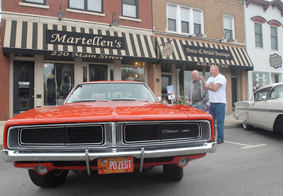 Erica Benson - ebenson@shawmedia.com Kerry Fierke of Naperville (left) talks with Ted Neitzke of Homer Glen regarding Ted's  1969 Dodge Charger during the Lemont car show Wednesday, June 5th 2013. The car show continues weekly throughout the summer.