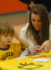"Ethan Spadafora of Lemont gets help from Lemont Park District employee Kaley Sullivan while making a Thanksgiving picture frame at the ""Awesome Autumn Family Fun Night"" held at the Park District  Friday Nov. 16, 2012.  Staff photo by Erica Benson"