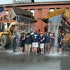 Members of the Leominster Fire Department accept the ALS Challenge on Wednesday by being drenched in about 1600 gallons of water and ice from front loaders lent by Quality Towing.  The event kicks off the Departments annual MDA fundraiser.