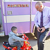 Mayor Dean Mazzarella greets Javien Nieves, 4, upon arriving to Leominster City Hall on Thursday evening for the Light the Town Purple event in honor of the upcoming Greater Gardner Relay for Life. SENTINEL & ENTERPRISE / Ashley Green