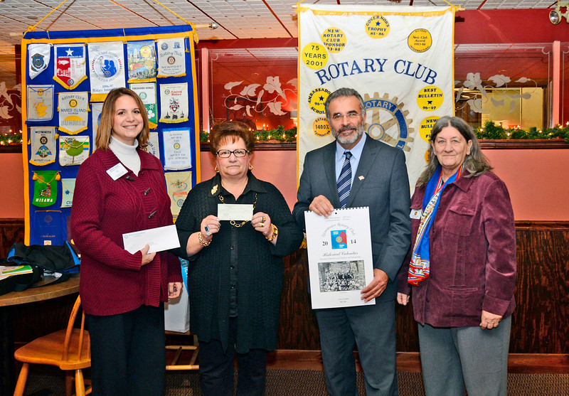 The Leominster Rotary Club donated $3,000 to Fraticelli Oil as part of Mayor Dean Mazzarella's Energy Fund on Monday at Cornerstones Restaurant. From left is Rotary Club President Mary Dean, Maryann Fraticelli, human resources from Fraticelli Oil, Mayor Dean Mazzarella, and Councilor Claire Freda.<br /> SENTINEL & ENTERPRISE / BRETT CRAWFORD